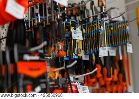 Hand Hold Ingco Drill Bits And Screwdriver Set At Supermarket Shelf.