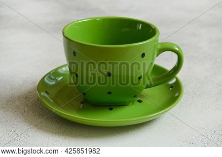 Eco Friendly Handmade Ceramic Tableware, Tea Pair, Green Cup And Sucer Polka Dot, Cutlery And Table