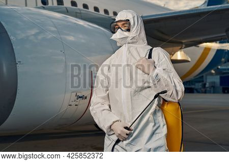 Man Dressed In A Hazmat Suit Looking Into The Distance