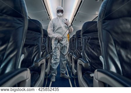 Airline Worker In A Hazmat Suit Posing For The Camera