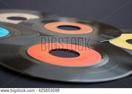 Macro Photography Of 7 Inch Single Vinyl Records On A Dark Background With Selective Focus. Backgrou