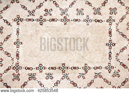 Horizontal ancient byzantine natural stone tile mosaics with floral ornament and geometrical frame. Copy space for text. Mock up template