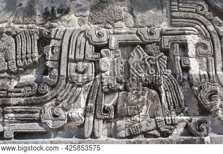 Bas-relief carving with of a american indian chieftain, pre-Columbian Maya civilization, Temple of the Feathered Serpent in Xochicalco, Mexico. UNESCO world heritage site