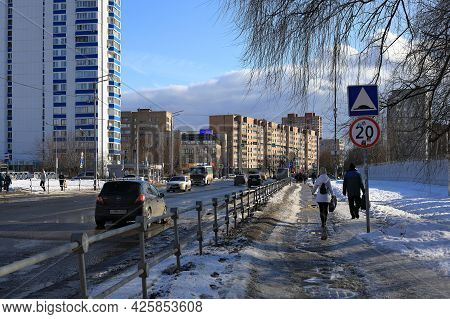 Balashikha, Russia - March 19, 2021. Residential Area On The Spring Sunny Day. Dirty Sidewalk Covere