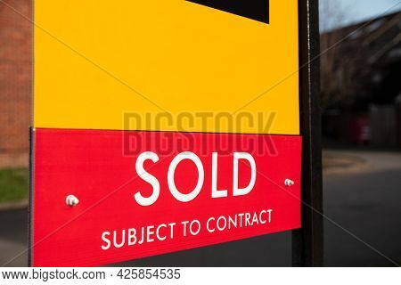 Close up Sold Subject to Contract Real Estate Agent Sign or Board