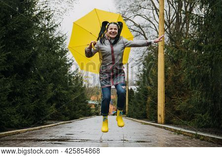 Happy Older Women Having Fun Outdoor. Senior Cheerful Mature Elderly Retired Woman With Yellow Umbre