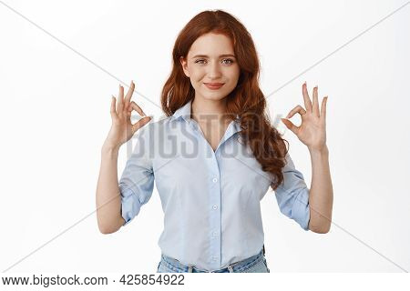 Okay, Everything Under Control. Smiling Redhead Woman Showing Ok Gesture With Confident And Assertiv