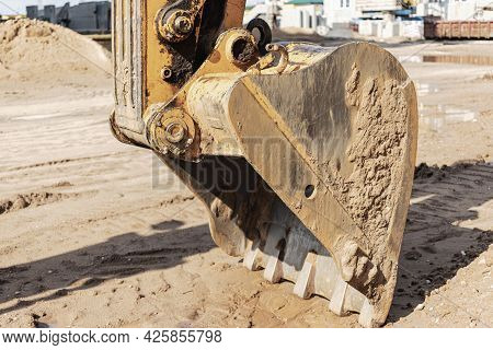 Excavator Bucket Close Up. Excavation Work At Construction Site And Road Construction. Construction