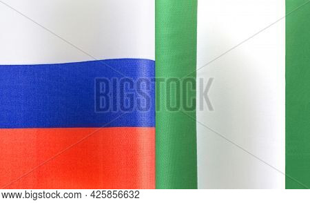 Fragments Of The National Flags Of Russia And The Republic Of Nigeria Close-up