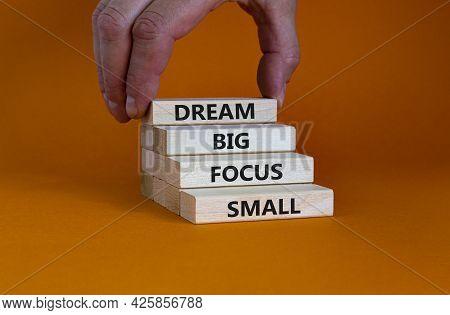 Dream Big Focus Small Symbol. Concept Words 'dream Big Focus Small' On Wooden Blocks On A Beautiful