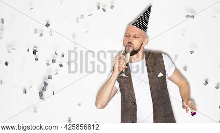 Birthday Party. Drunk Man. Holiday Joy. Festive Celebration. Silly Guy Drinking Champagne Wearing Ho