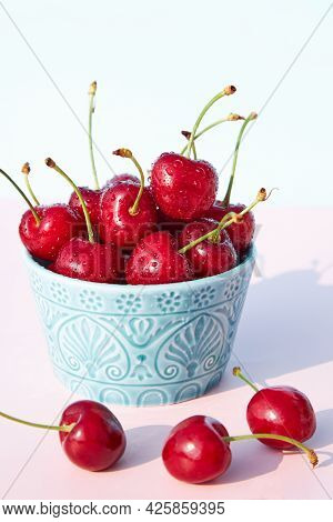 Close-up Of Fresh, Juicy And Ripe Cherries In A Turquoise Ceramic Bowl Against A Light Background. S