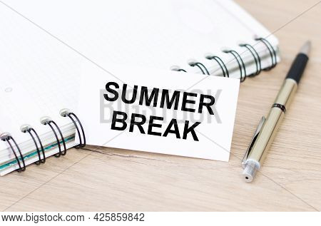 Summer Break Inscription On A Catheter Next To A Notepad On The Rings On A Wooden Table