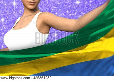 Pretty Girl Is Holding Gabon Flag In Front Of Her On The Blue Shining Sparks Background - Flag Conce