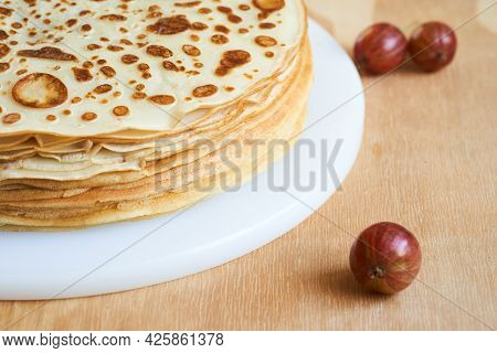 Stack Of Homemade Blinis. Widely Popular Russian Dish. On The Wooden Table