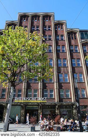 Dusseldorf, Germany - September 19, 2020: People Walk By Rheinische Post Newspaper Head Office In Du