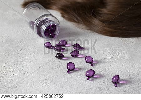 Hair Vitamin Capsules On A Gray Background: Hair Treatment And Care Products With Oil For Damaged, H