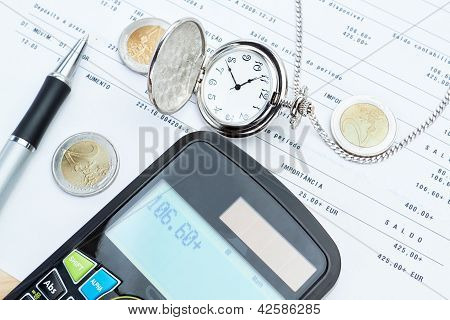 Calculator, Pocket Watches, Money Against Bank Calculations.