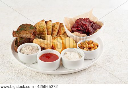 A Set Of Snacks For Beer. From Croutons, Pita Bread, Smoked Sausage And Nuggets. Served With Three T