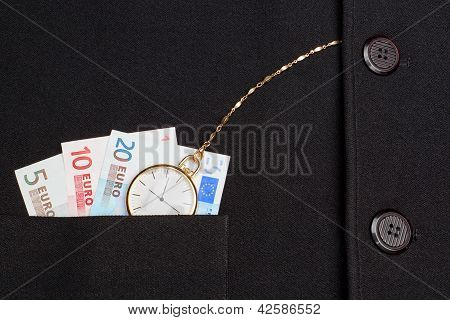 Concept Photo Of A Pocket Watch In A Jacket On A Background Of Money Euro.