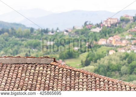Clay Tiles Close-up. Old Tiles On The Houses Of Tuscany. The Old Technology Is Better Than The New O