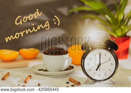 A Black Alarm Clock Indicates The Time Is 7:00 Am And The Text Is Good Morning. Retro Clock And Back