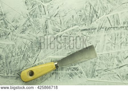 Construction Trowel On The Table In The Process. Renovation Process, Background With Copy Space. Put