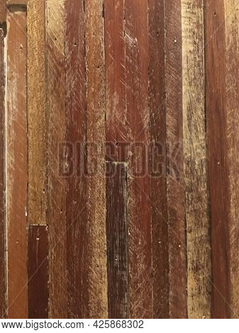 Dark Wood Texture.the Vertical Images Are Arranged Neatly Together.