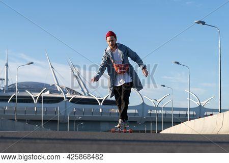 Casual Skateboader Man Skateboarding Over Urban Space Background. Hipster Man Wearing Trendy Street