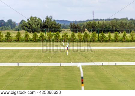 Several Free Fields Are Prepared For Playing Croquet, The Field Is Cut With A Wicket And Signs