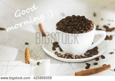 White Cup With Coffee Beans And The Text Good Morning. Good Morning Written. Coffee Beans In A Coffe