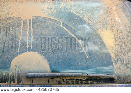 Dirty Heated Rear Window Covered With A Layer Of Dust With A Wiper Blade Swipe Close-up, Dirty Blue
