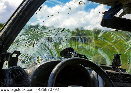 Windshield View From The Interior Of A Car Through A Window Covered With A Layer Of Dried Swamp Afte