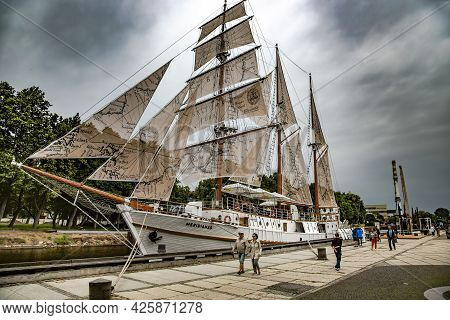Lithuania, Klaipeda, July, 2020 - Wooden Old Frigate Meridian  In Vintage Style With All Sails Set N