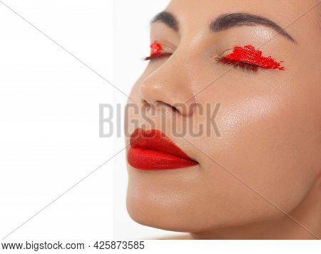 Close Up Portrait Of A Beautiful Young Female Face With Red Lips And Long Brown Hair. Classic Make O
