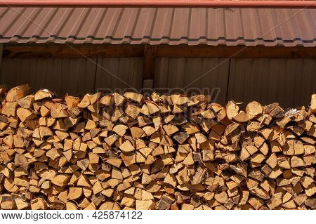Laying Firewood. A Pile Of Logs. Stacks Of Firewood. Preparing For Winter.