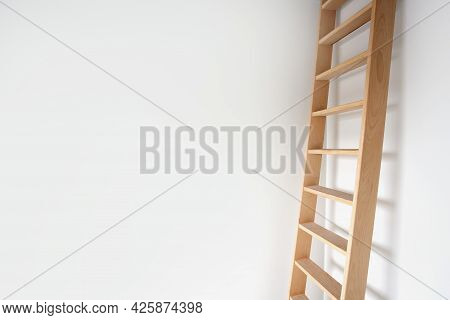 Sideview Of A Wooden Ladder Leaning Against White Wall Modern Design, Stylish Stairs In Bright Room