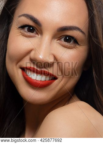 Close-up Beauty Of Half Female Face Withevening Make-up. Black Arrows On The Eyes And Extremely Long