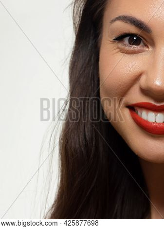 Half A Beauty Portrait With Beautiful Fashionable Evening Make-up, Black Lines, Red Lips And Extreme