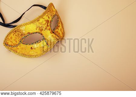 Carnival Mask On Color Background. Purim Celebration Concept (jewish Carnival Holiday). Masquerade P