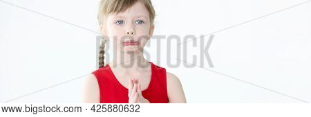 Portrait Of Little Offended Girl With Blue Eyes