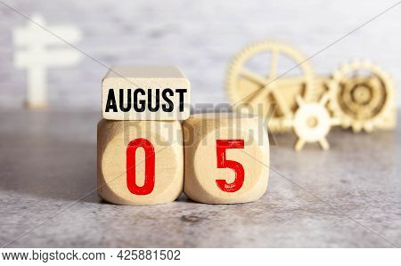 Cube Shape Calendar For August 05 On Wooden Surface With Empty Space For Text.