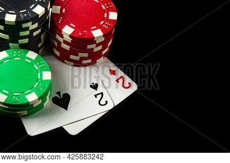 Poker Game With One Pair Combination. Chips And Cards On The Black Table In Poker Club.free Advertis