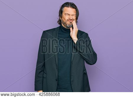Middle age handsome man wearing business clothes touching mouth with hand with painful expression because of toothache or dental illness on teeth. dentist