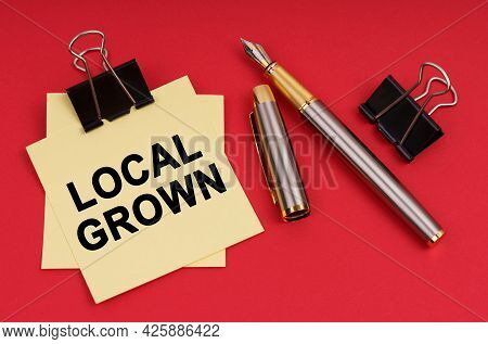 Business Concept. On A Red Background, A Pen And Stickers With The Inscription - Local Grown