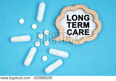 Medicine And Health Concept. On A Blue Background, Pills And A Plate, Inside Which The Inscription -