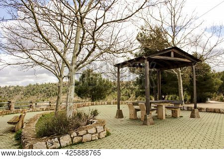 Picnic With Chairs And Stone Table In A Mountain Viewpoint In Castilla La Mancha, Spain