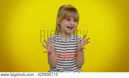 Portrait Of Funny Playful Blonde Kid Child Shouting, Raising Hands In Gesture I Did It, Celebrating
