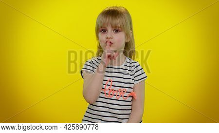 Shh Be Quiet Please. Portrait Of Funny Blonde Child Girl 5-6 Years Old Presses Index Finger To Lips
