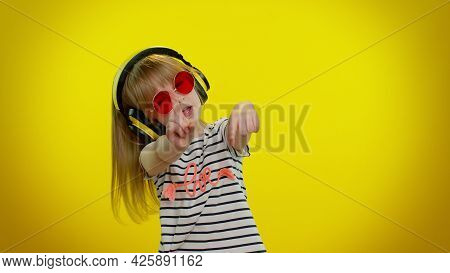 Funny Playful Blonde Kid Child 5-6 Years Old Listening Music Via Headphones, Dancing Disco Fooling A